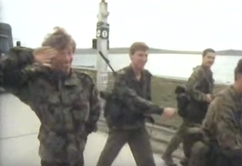 Jim giving a Fred Scuttle salute while marching with the boys