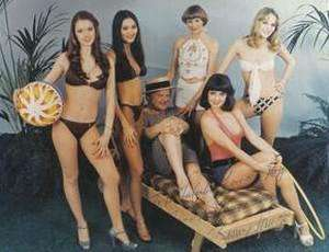 The Members of Love Machine pose with Benny (seated) for a photo. Left to Right: Lorraine Doyle (Greening), Claire Lutter, Libby Roberts, , Teresa Lucas (seated with Benny) and Jane Eve (Colthorpe)